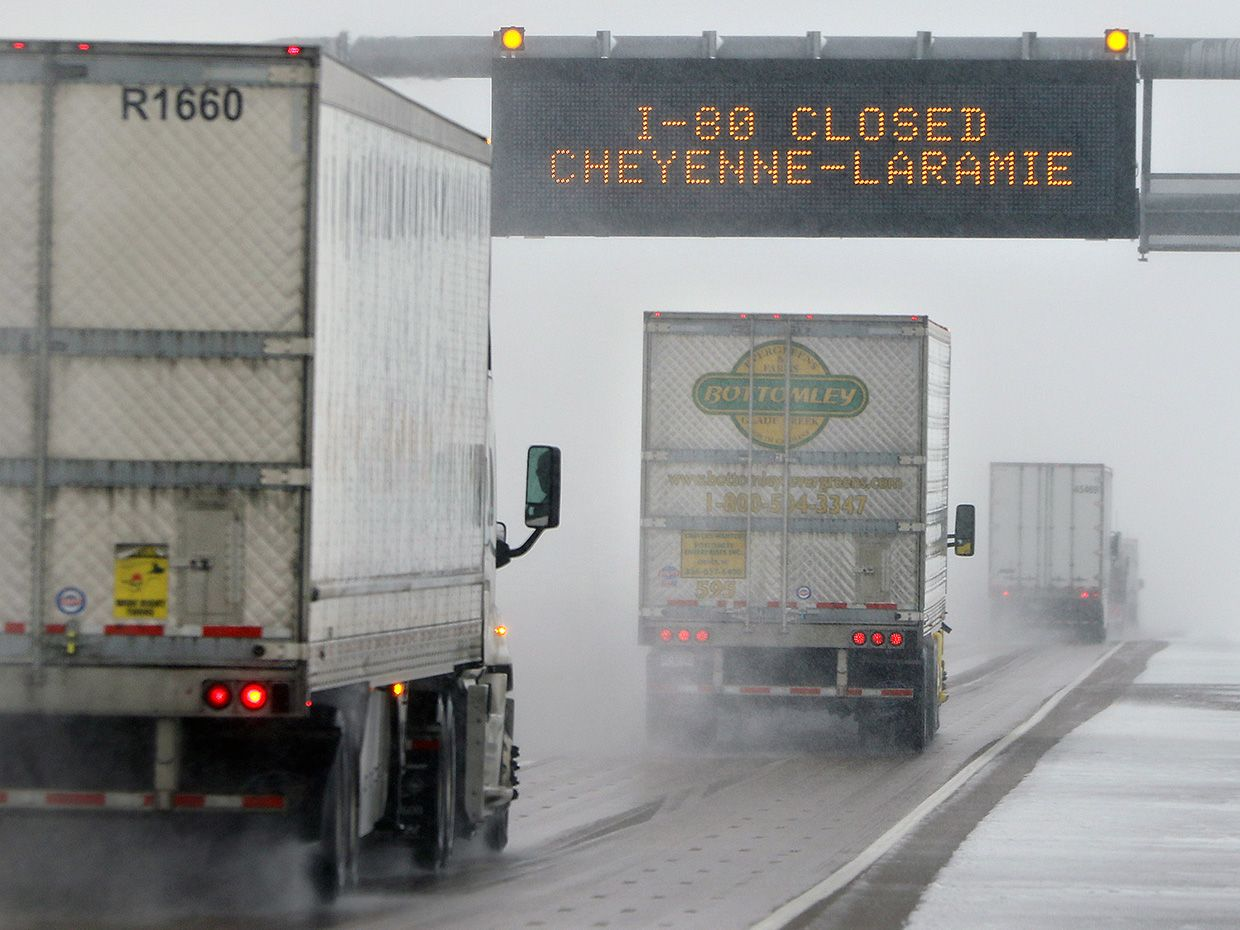 Truck drivers head toward Cheyenne, Wyo., in limited visibility at mile marker 373 on Interstate 80