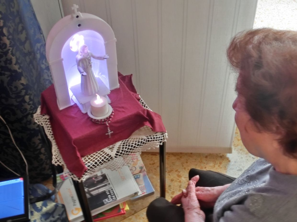 A robot with the appearance of a Christian Catholic saint can pray together with users and cite parts of the Bible and stories of the life of saints.