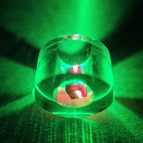 The maser effect appears as a green glow from a laser with the diamond in red