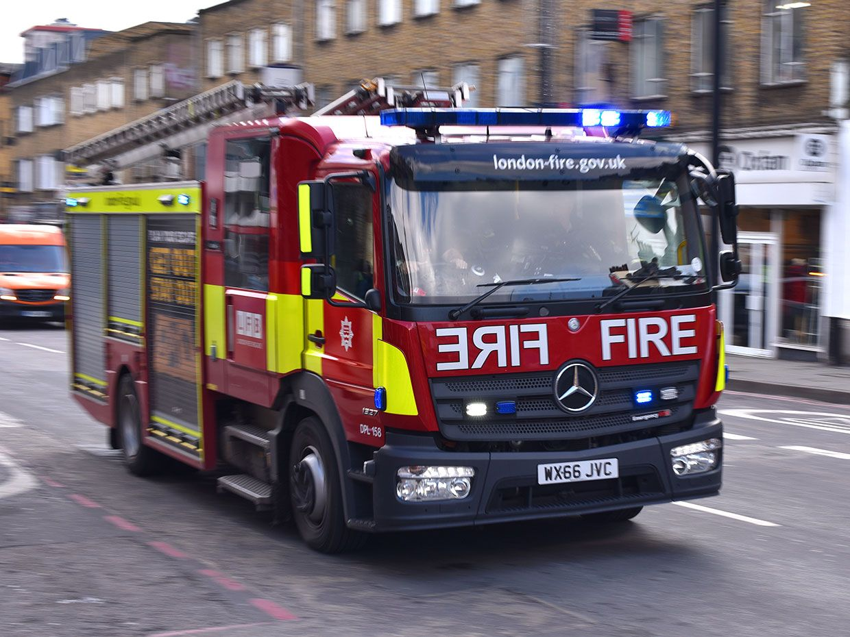An emergency Fire engine responds to an emergency with in London, England.