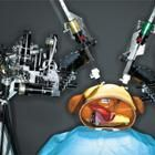 "remote-controlled two-armed surgical robot ""operates"" on a plastic and rubber anatomical model of a human torso."