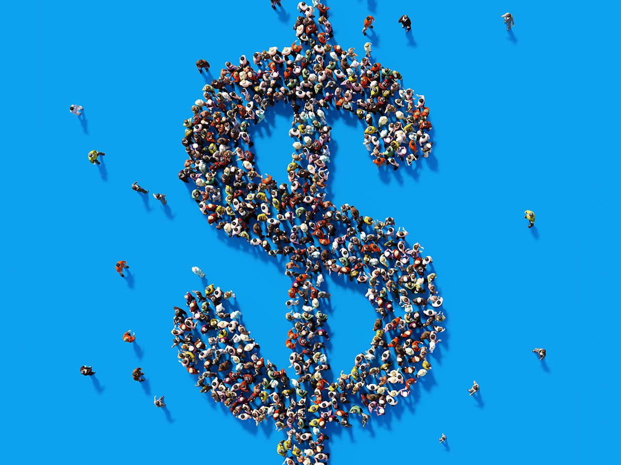 Conceptual photograph of a crowd of miniature people forming a dollar sign.