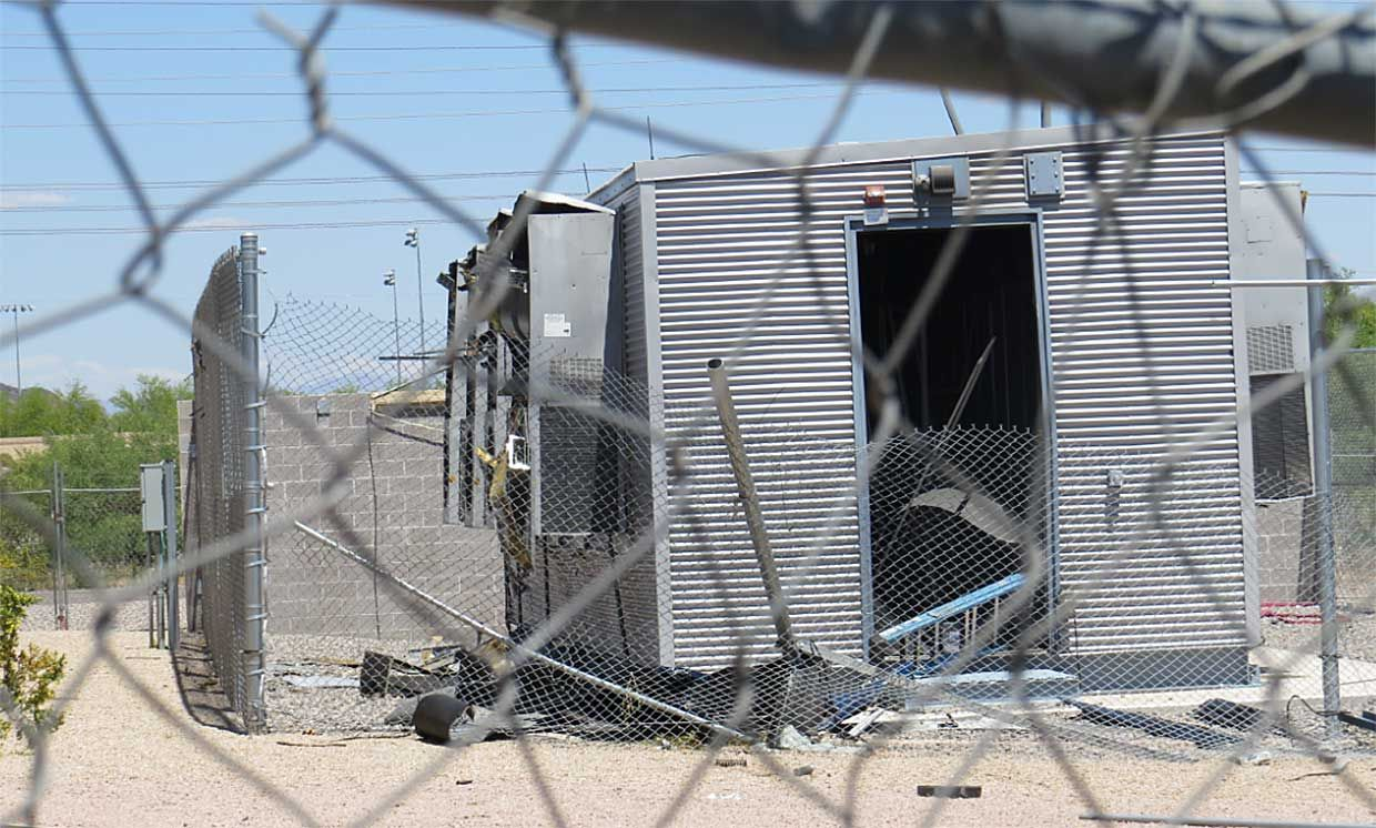 View of debris and damage to the rear door, HVAC systems, and the container.