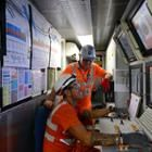 Workers operate a tunneling-machine computer system at a Crossrail site in East London.