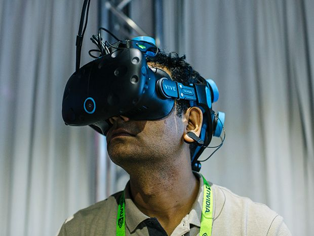 A man wears a VR headset to play a mind-controlled game in virtual reality.
