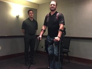 Paraplegic user of the Ekso exoskeleton stands and walks with the help of the robotic system.