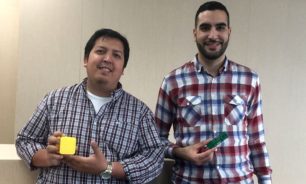 Sucre Cando and Nassim Bettach hold parts of a prototype wildfire detection sensor