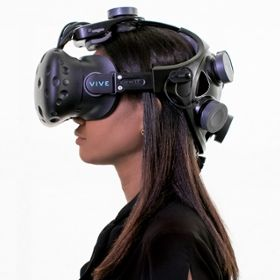 Photo of person wearing VR headset.