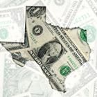 A torn dollar bill in the shape of the state of Texas