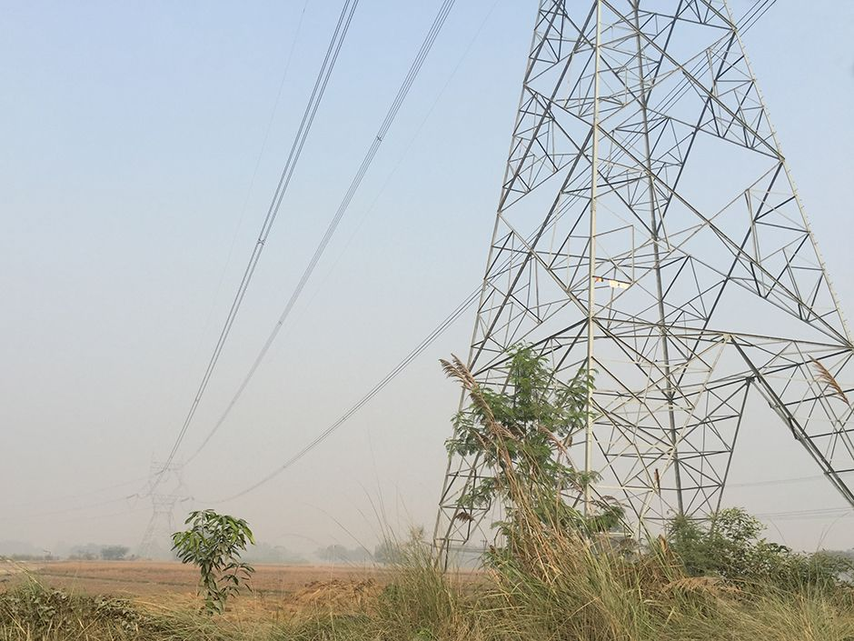 "India has built high-voltage transmission lines that span vast distances. But the country has a ""last mile"" problem: Often people living beneath these power lines do not have access to electricity."