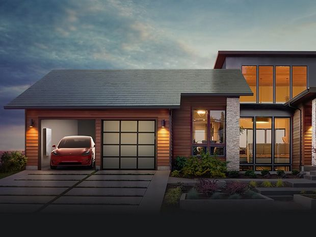 A home pictured with Tesla's solar roof, a car, and new Powerwall battery as the sun falls