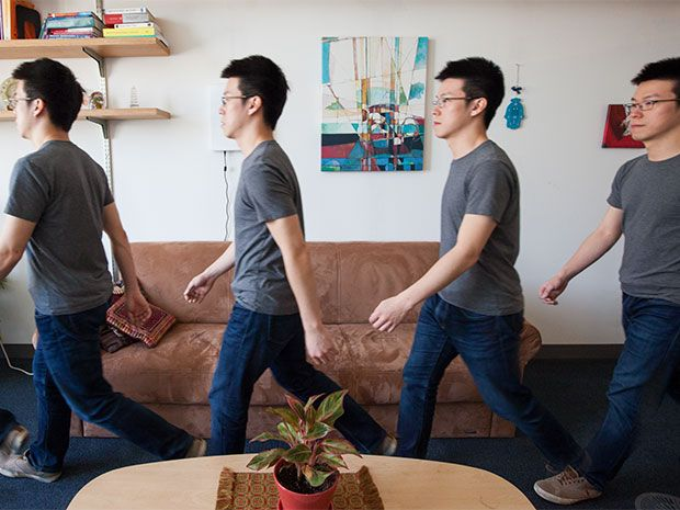 Four images of a man walking across a room between a coffee table and a sofa