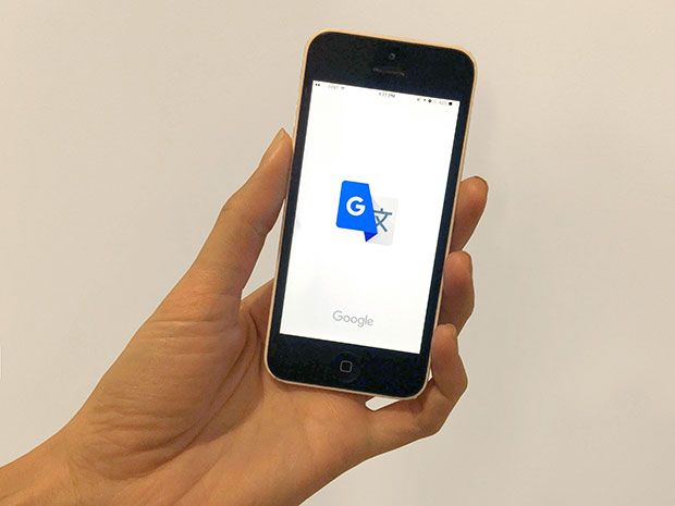 The Google Translate icon on the screen of a smartphone