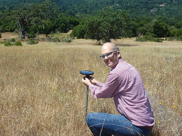 Arable founder Adam Wolf with his plant- and environment-monitoring Internet of Things device