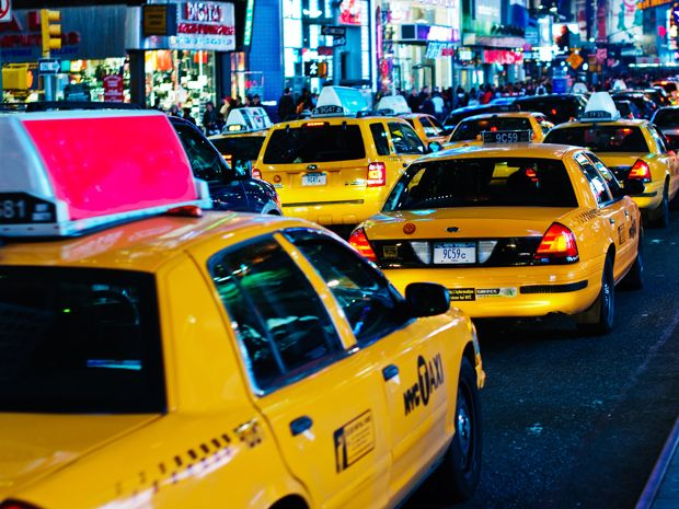 Taxi cabs in traffic.
