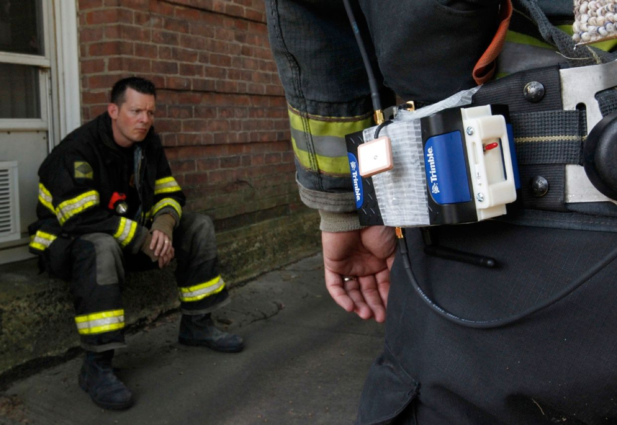 The Worcester, Mass., firefighter in the foreground is shown wearing a personal tracking device from Trimble Navigation of Sunnyvale, Calif., during a simulated rescue exercise. The device, which is not commercially available, would allow a commander on the scene to pinpoint the exact location of a first responder who is injured or trapped inside a smoke-filled building.