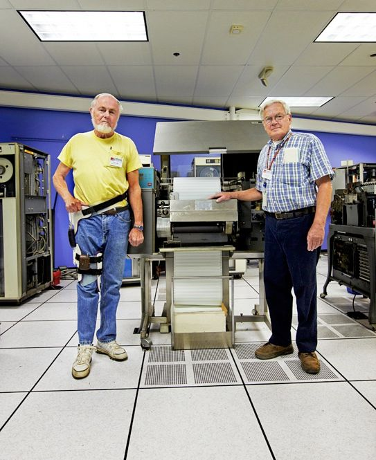 RIP AND READ: IBM's 1403 printer printed faster and more clearly than previous devices. It used a chain of letters moving horizontally so that each hammer would hit a selected letter just as it passed by. That way, any timing error would affect only the spaces between the letters. Don Luke [left] and Frank King restored it.<