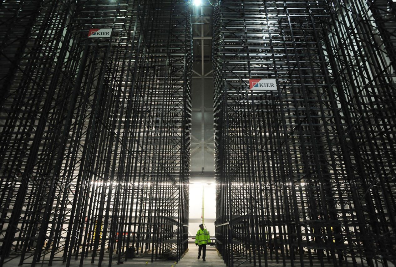 This image shows the massive scale of the soon-to-be-completed Newspaper Storage Building at Boston Spa, in West Yorkshire, England. The building will serve as the central repository for the British Library's collection, which includes more than 300 years of print newspapers. The 64- by 24- by 24-meter space will be outfitted with robotic shelving, so no human will ever have to go inside. To keep the newsprint from degrading or catching fire, there will be close monitoring of temperature, humidity, light, and oxygen levels.