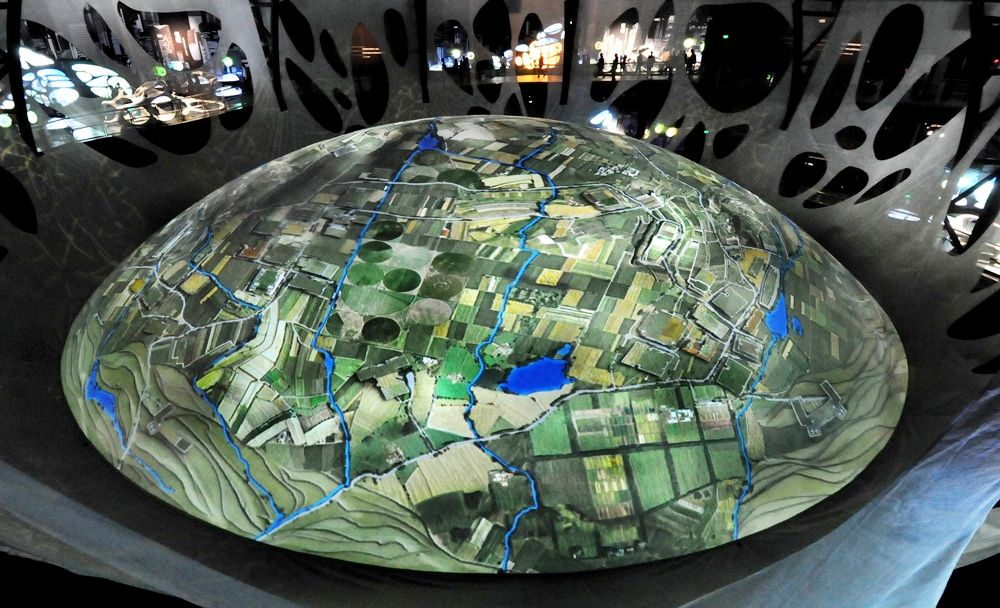 The Pavilion of the Urban Planet also contains this screen showing a view of the Earth from space that can zoom in and out, Google Maps style.