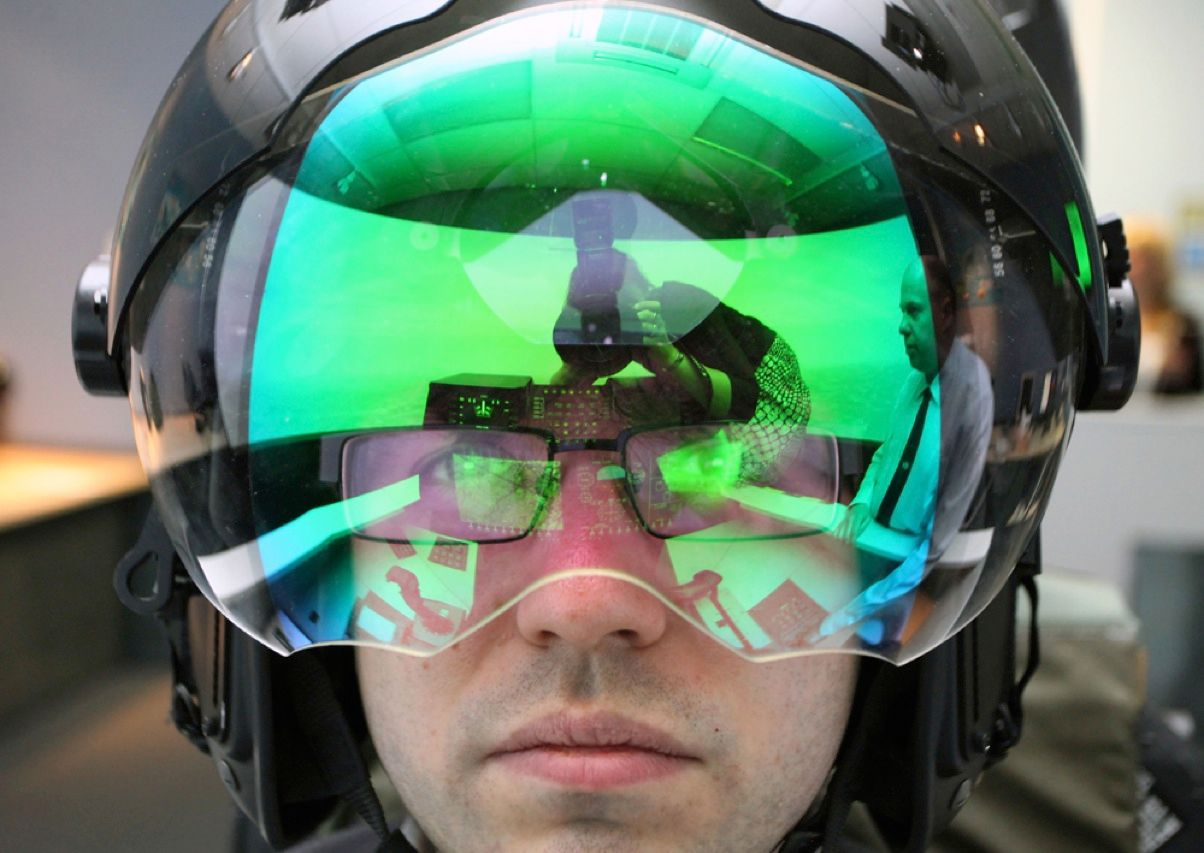 An engineer at the BAE Systems plant in Rochester, England, is shown wearing the same helmet that pilots of the Eurofighter Typhoon fighter jet will wear in combat. A suite of sensors projects images right onto the visor, giving the pilot a 360-degree view in all directions and putting vital information—such as the location of enemy aircraft or missiles and his own heading, speed, and elevation—right before his eyes.