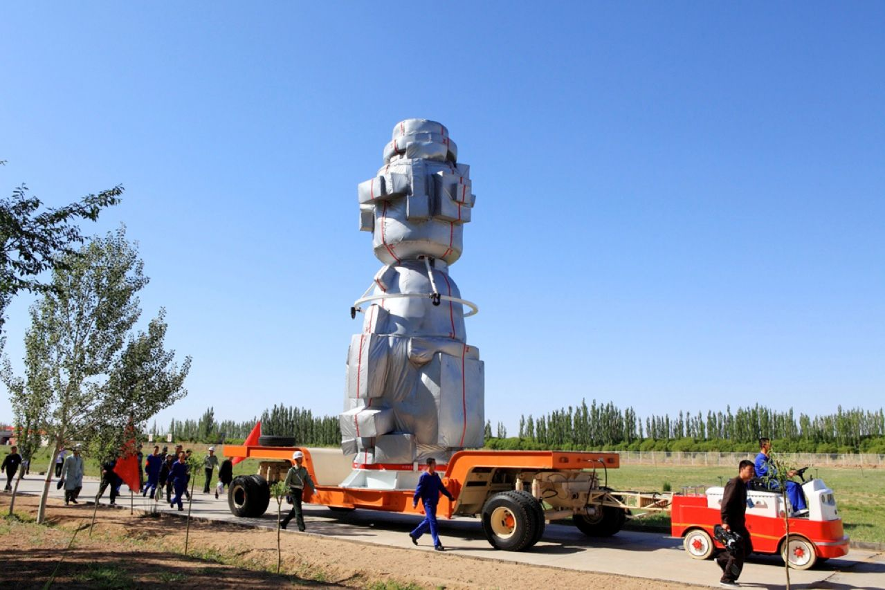 China's Shenzhou-9 capsule is shown being transported to a fueling station before a Long March 2F rocket lifted it to a successful rendezvous with the Tiangong-1 space lab on 18 June. The launch of the capsule marks the first time China has sent a female astronaut into orbit. When Shenzhou-9 reached the space lab, orbiting about 340 kilometers above Earth, it went on autopilot, using radar, lasers, and optical sensors to dock with the space lab.