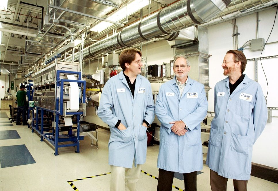 THE COLORMAKERS: Brian Busch, Stephen Herchen, and J.C. Van Dijk [from left] and dozens of other engineers and scientists took ink-free color technology under development at Polaroid Corp. and made it a reality at Zink Imaging.