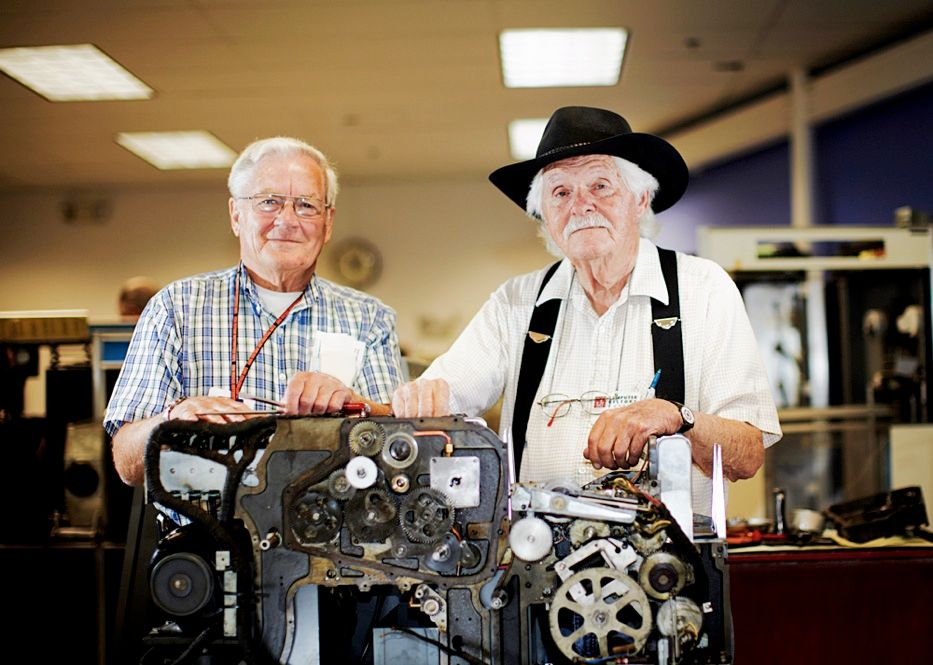 BIG WHEELS, KEEP ON TURNING: IBM's 513 reproducing punch, shown with rehabbers Frank King [left] and Robert Erickson. <