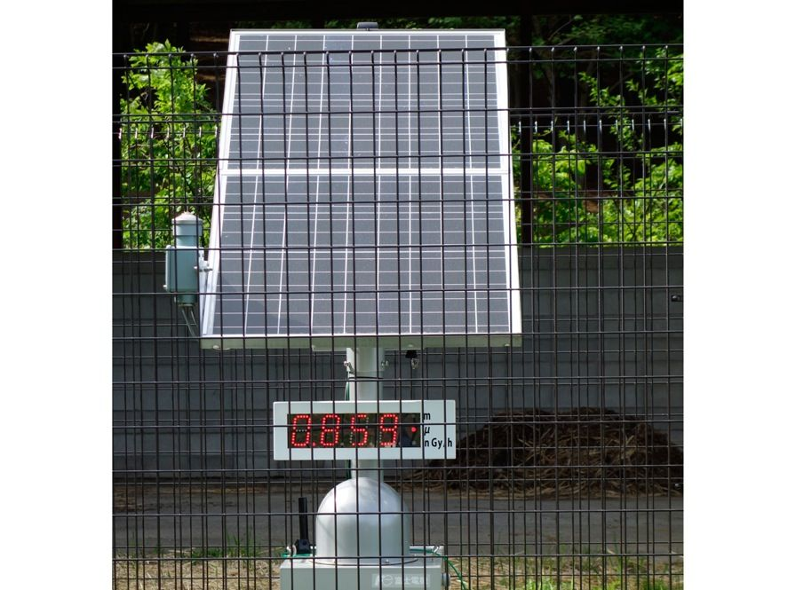 "<b>By the Numbers:</b> The Japanese government has installed radiation monitors throughout much of Fukushima Prefecture to keep residents informed of current radiation levels. This monitor's display reads 0.859 microsieverts per hour, which equals 7.5 millisieverts per year. The government has declared that towns <a href=""http://www.nsr.go.jp/english/library/data/special-report_20140204.pdf"">can be reoccupied</a> if the radiation dose is below 20 mSv per year, which is the typical safety threshold for nuclear workers."