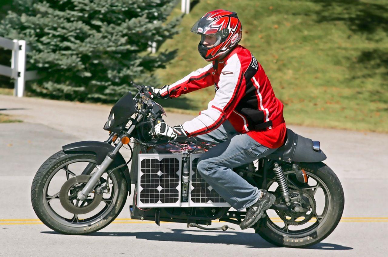 The owner of this Suzuki GS 550 spent US $2500 replacing its gasoline engine and fuel tank with an electric motor, lead-acid batteries, and two sets of solar panels. When the bike is parked, the panels can be flipped up to capture the sun's rays. The batteries, good enough for 38 kilometers on a single charge, can also be topped up from a wall socket.