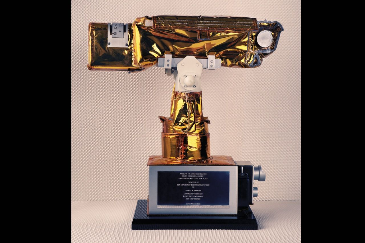 "<strong>Autographed model of Apollo 15 camera (1971):</strong>  During the 1960s, RCA continued to develop smaller, lighter-weight color TV equipment. Among the beneficiaries of this work was NASA, which mounted an <a href=""http://blog.nasm.si.edu/history/leaving-the-moon-watching-at-home/"">RCA camera on the lunar rover used during the Apollo 15 mission</a>. The camera could be operated remotely by mission control personnel in Houston. NASA was so pleased with the system's performance that it asked RCA to supply cameras for the Apollo 16 and 17 missions. The model shown here was signed by the Apollo 15 crew and presented to RCA chairman and CEO Robert Sarnoff; the original camera remains on the moon."