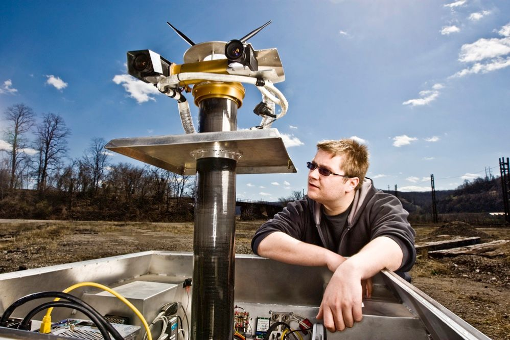 ELECTRIC EYES: Cameras mounted on a pan-tilt head capture high-resolution stereo images. Michael Furlong, a robotics grad student, is developing software to convert the images into three-dimensional maps. <