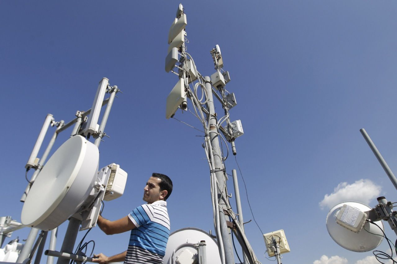 An engineer with TerraNet, Lebanon's fastest growing wireless Internet service provider, inspects antennas designed to make the entire country a Wi-Fi hot spot. But service there is still spotty and costly, with monthly broadband wireless charges as high as US $300.