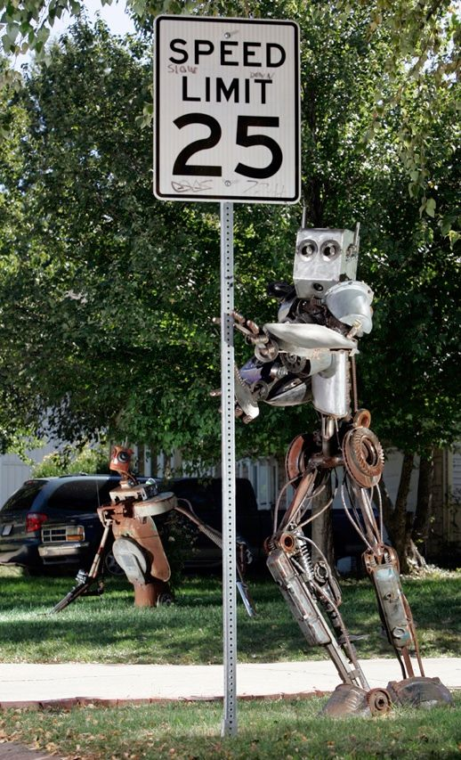 It's probably more accurate to call the humanoid posing by this traffic sign a sculpture instead of a robot because it doesn't move on its own. Its creator, a self-trained artist with no engineering background, made the 2.1-meter-tall, 360-kilogram eye-catcher from parts scavenged from his Kansas City, Mo., hometown.