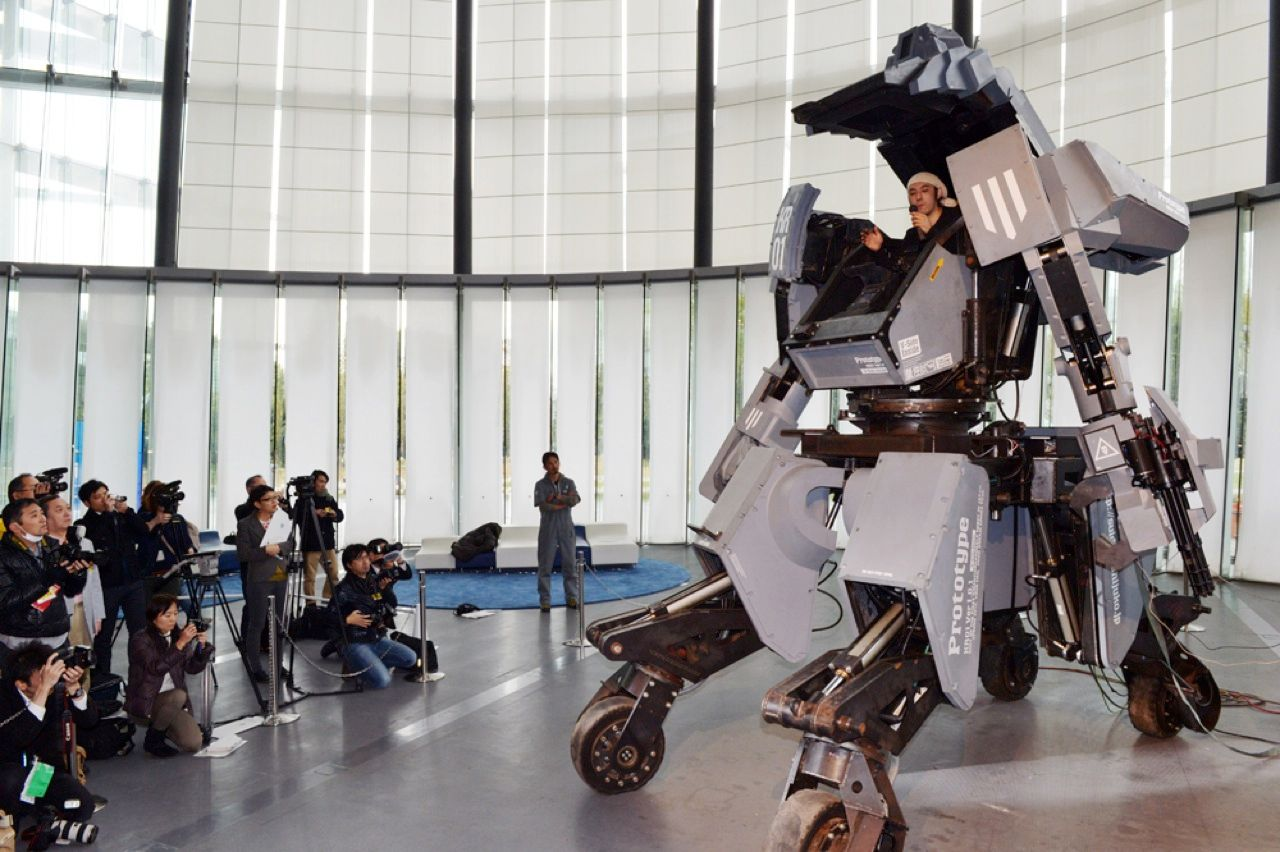 Kogoro Kurata, a Japanese designer and artist, shows off the robotic creation that he has dubbed Kuratas. The 4-metric-ton, 4-meter-tall machine can be piloted from the cockpit—where Kurata is perched—or remotely from an iPhone. The combative robot features a sensor system that locks onto a target before its twin Gatling guns together fire more than 6000 BB pellets per minute. This is no one-off project. Its creator says he plans to sell Kuratas for US $1.3 million.