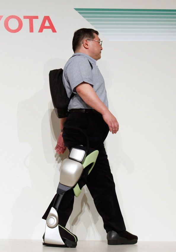 Fujita Health University professor Eiichi Saito, whose right leg was paralyzed by polio, demonstrates Toyota's Independent Walk Assist robot. The robot, which is powered by a set of batteries that Saito is carrying in the backpack, bends his knee and ankle to enable a naturalistic gait. Toyota says that the machine, which was one of several showcased at a 1 November health-care robots event, will be commercially available by 2013.