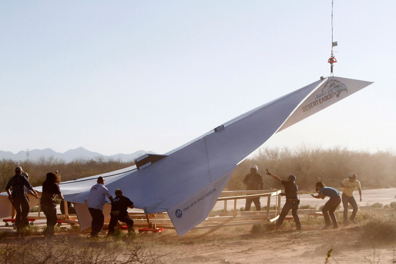Every small boy's fantasy has been lived out by engineer Art Thompson and workers at the Pima Air and Space Museum in Eloy, Arizona. They hooked up a 13.7-meter-long paper airplane to a helicopter, dragged it to a height of 1219 meters, and released it over the desert. The plane, dubbed Arturo's Desert Eagle, glided 1.5 kilometers before making a spectacular crash landing.