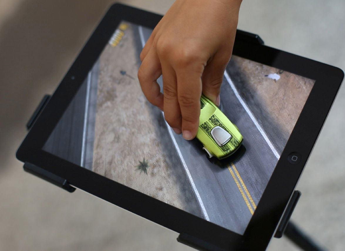 Is there any iPad owner out there willing to let a 5-year-old use the device's screen as a track for racing toy cars? That's exactly the proposition being made by toy maker Mattel, which has introduced an iPad app that lets toys such as Hot Wheels cars and action figures interact with the tablet computer.