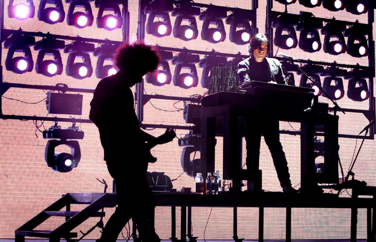 JAMMING WITH REZNOR: Reznor records and performs under the name Nine Inch Nails, but he also goes out on the road backed by other musicians, including the two pictured here, for live shows.<
