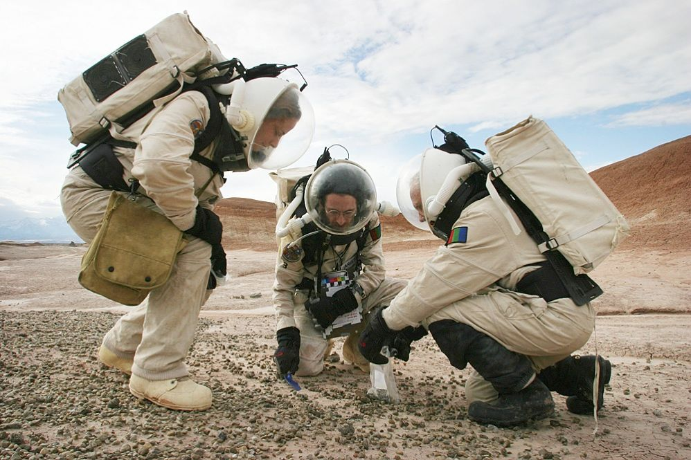 "TOOLS OF THE TRADE: A <a href="" http://www.marssociety.org/ "">Mars Society</a> crew conducts field studies in the Utah desert in their space suits to determine what tools they will need for their mission. ""The most important step in any engineering process is not deciding how to design something,"" says Mars Society president Robert Zubrin. ""It's making sure you're designing the right thing."""