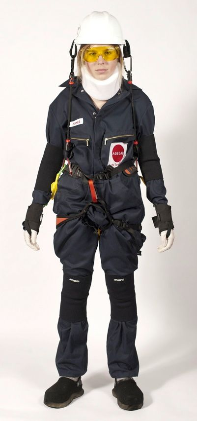 The woman seen here is not about to be lowered into a mine. The gear she is wearing is not for protection but to make her feel old. The Age Gain Now Empathy System suit was developed by researchers at the MIT AgeLab. The aim is to help product designers and marketers experience the physical limitations of the elderly.