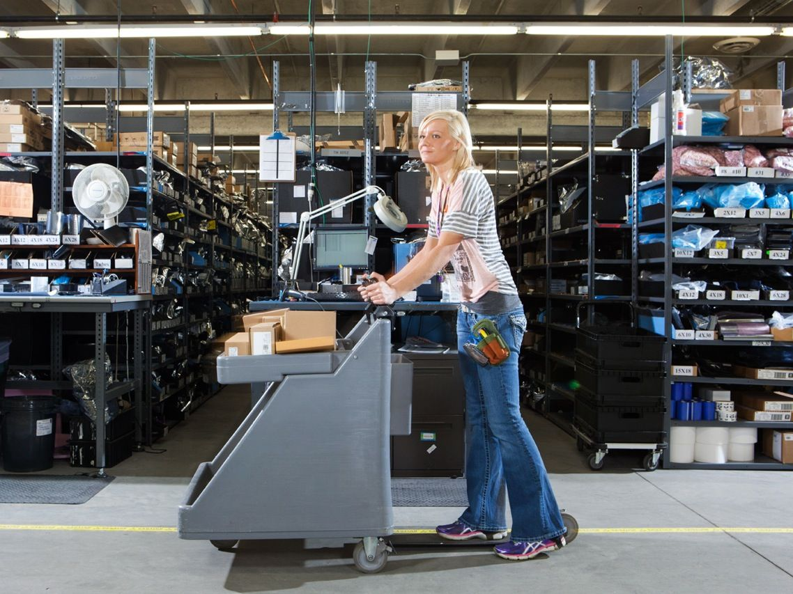 "<b>TO GO:</b> Digi-Key guarantees that any order placed by 8 p.m. U.S. central time will be shipped out the same day. To move packages efficiently around Digi-Key's huge warehouse, Danielle Wollin relies on a specialized scooter cart, called a <a href=""http://www.mousecart.net/"">MouseCart</a>."