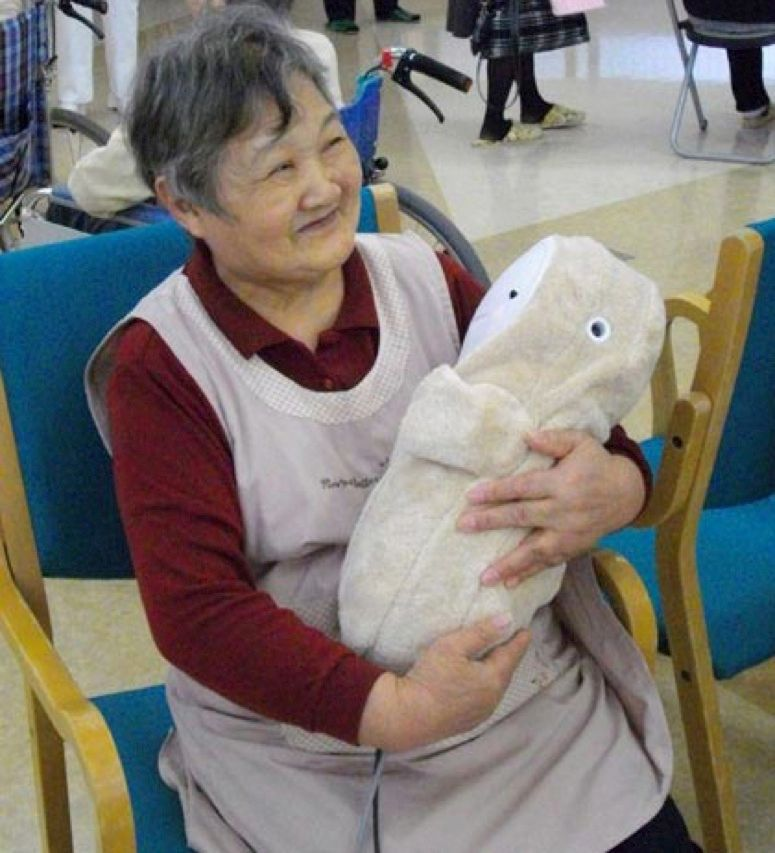 Babyloid is a robotic baby doll created at Chukyo University, in Nagoya, Japan. It can work as a therapeutic tool and also monitor the elderly. That's right: The elderly take care of the robot, which takes care of the elderly.
