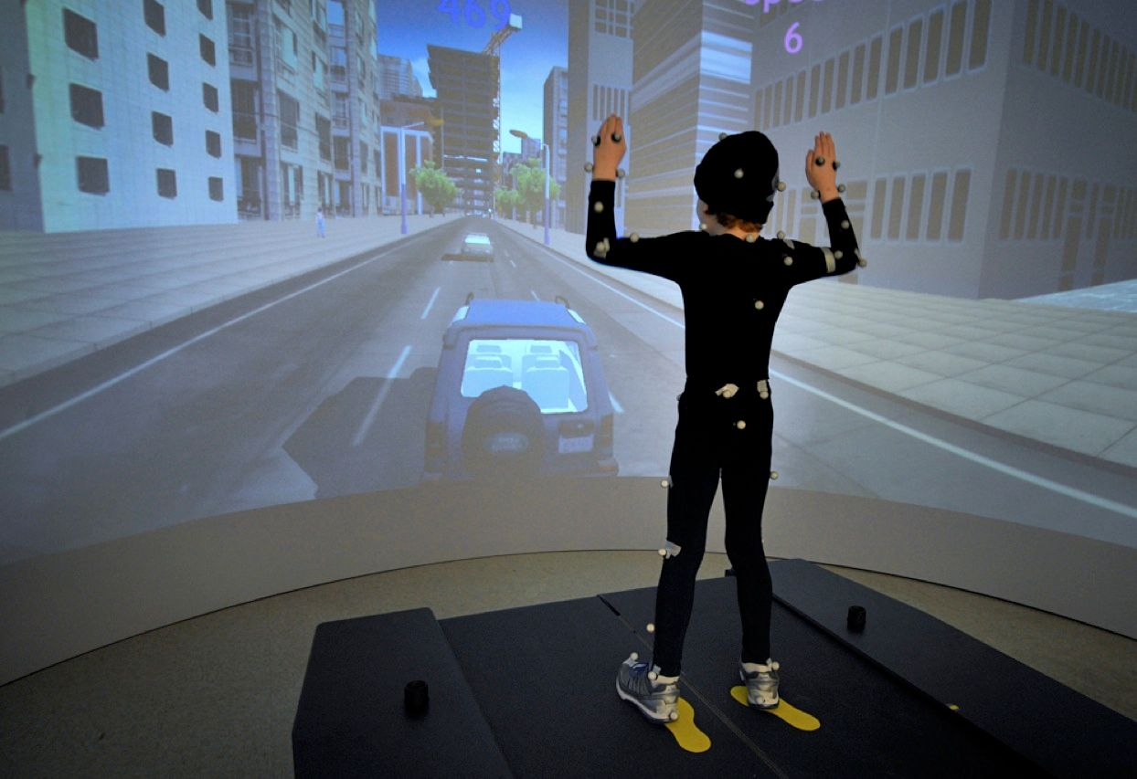 Anthony Arceri, a 7-year-old autistic boy, interacts with a virtual reality video-game system while wearing a motion capture suit. The exercise is one of several activities that researchers from the Texas Medical Research Collaborative hope will help them gather data that will improve their ability to diagnose and treat autism.<