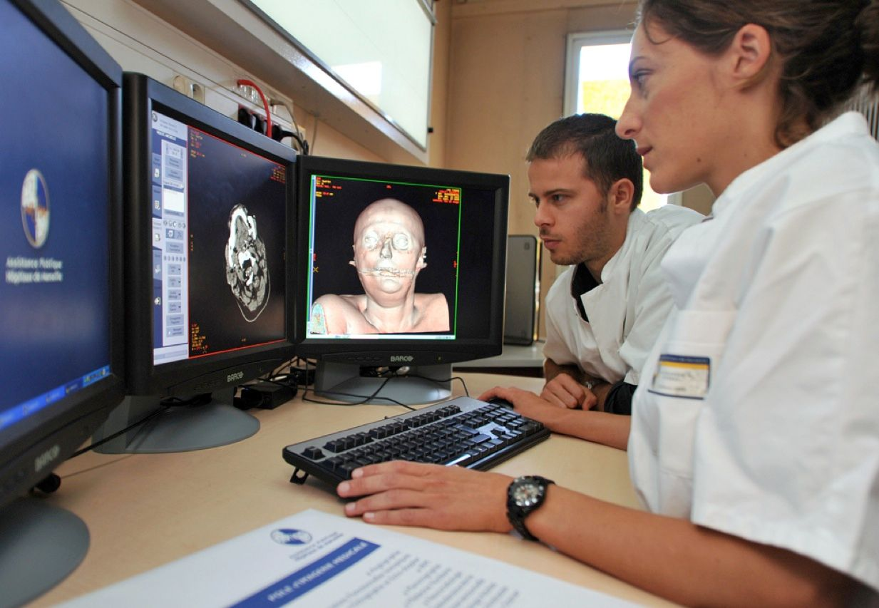 These radiologists at Timone Hospital in Marseille, France, are looking at digital images of a corpse. The scans, obtained using computerized tomography, magnetic resonance imaging, and sonography, will allow pathologists to conduct virtual autopsies from anywhere in the world. The technique makes it possible to noninvasively deduce the cause of death and will also make images used for police investigations more helpful.