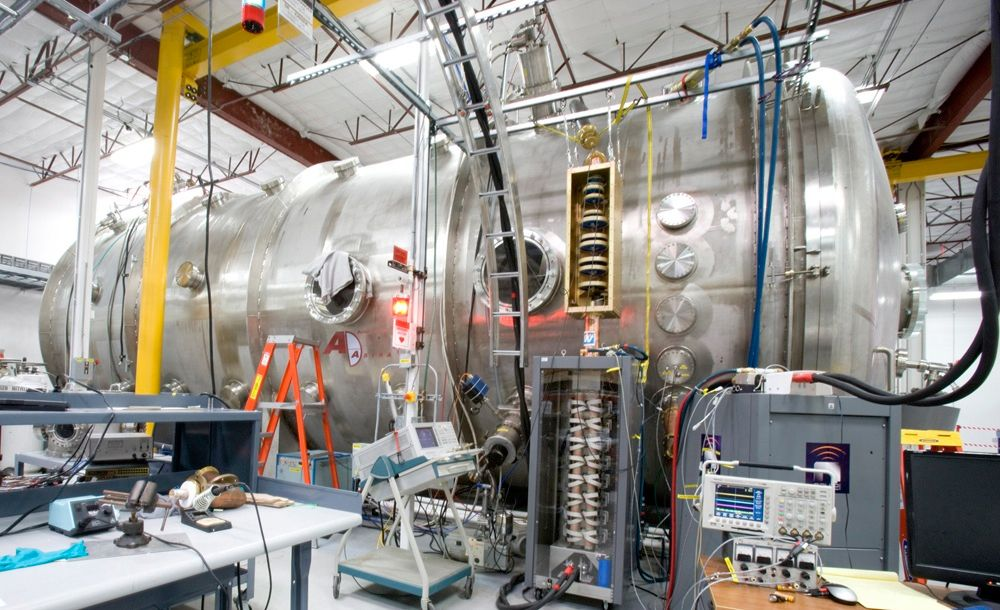 MOTHER SHIP: In Houston, at Ad Astra's headquarters, a larger version of the thruster is installed inside a vacuum chamber. Cryogenically cooled superconducting magnets wrap the plasma in magnetic fields and two stages of radio-frequency heating accelerate the plasma out a magnetic nozzle. This thruster can operate at 200 kilowatts, and higher power levels will enable it to produce even more thrust. The next step will be to build and test a 500-kw thruster.