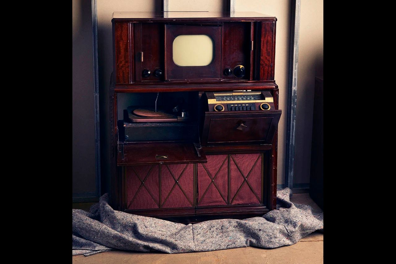 "<strong>TV Console Model 641 (c. 1947):</strong>  The U.S. government banned commercial television production during World War II, but RCA took advantage of this hiatus to improve its TV assembly lines and reduce costs. In 1946 <a href=""http://books.google.com/books?id=TOMOmmrvwCcC&lpg=PA18&ots=WvBzF7s3vs&dq=history%20of%20"">RCA introduced its first mass-market black-and-white set</a>, the RCA 630-TS, which sold for $375. The following year, the company released a console version of the same set, the RCA-641, combining AM, FM, and shortwave radios, a phonograph, and a television—a precursor of today's home entertainment system. RCA sold 8000 of these ""Five-in-One"" consoles at a market price of $795."