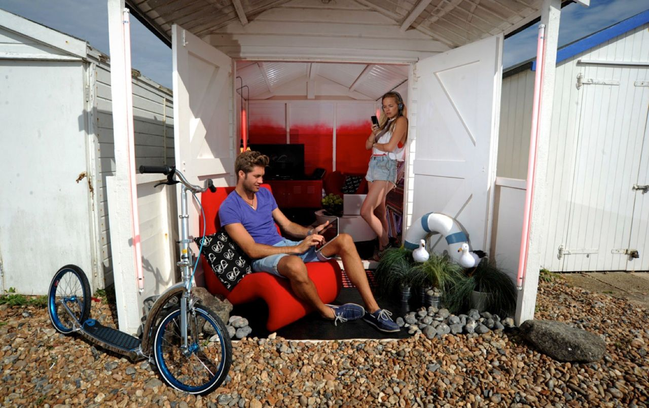 It used to be that you went to the beach to get away from it all. But Virgin Media's high-tech beach hut, on the sand at Beach Green in West Sussex, England, has been outfitted with a suite of electronic media gear that might make the sun and the surf an afterthought. Among the devices in the 3- by 2.4-meter hut, which uses wind power for its lighting, are a Samsung Smart TV with 3-D, a wireless sound system, a Microsoft Xbox Kinect, and a home weather station.