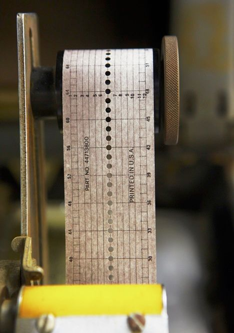 FIT TO PRINT: In older systems, in which character-carrying cylinders rotated vertically, such a timing error would cause the machine to print a letter above or below the line, making the text hard to read. The tape [above] controlled the 1403's movement. <
