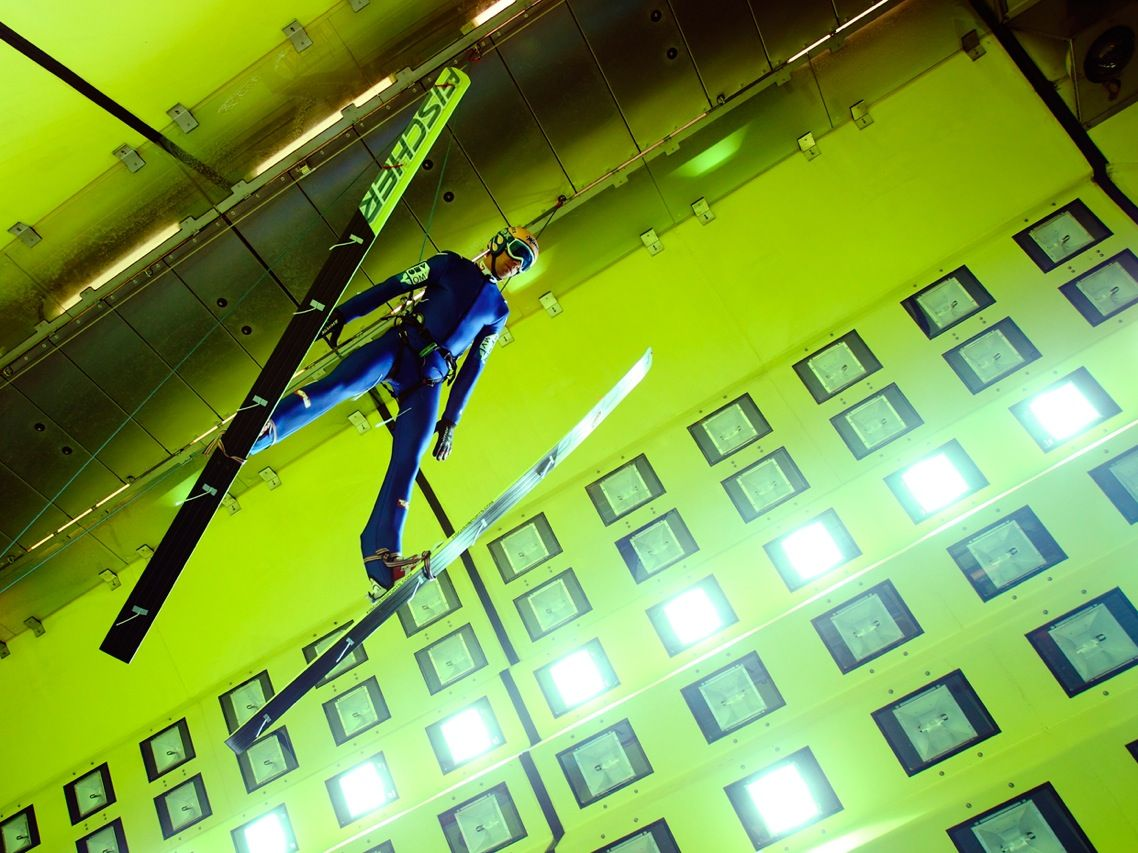 Austrian ski jumper Andreas Kofler is shown flying into a 105-kilometer-per-hour headwind in an effort to improve his technique. The conditions Kofler will face on the slopes at the Winter Olympics this month were re-created indoors at the Rail Tec Arsenal Climatic Wind Tunnel complex in Vienna. The facility is normally used to test how vehicles stand up to snow, ice, wind, and hot summer sun. It can simulate conditions from –45 °C to 60 °C, humidity up to 98 percent, and wind speeds up to 300 km/h.