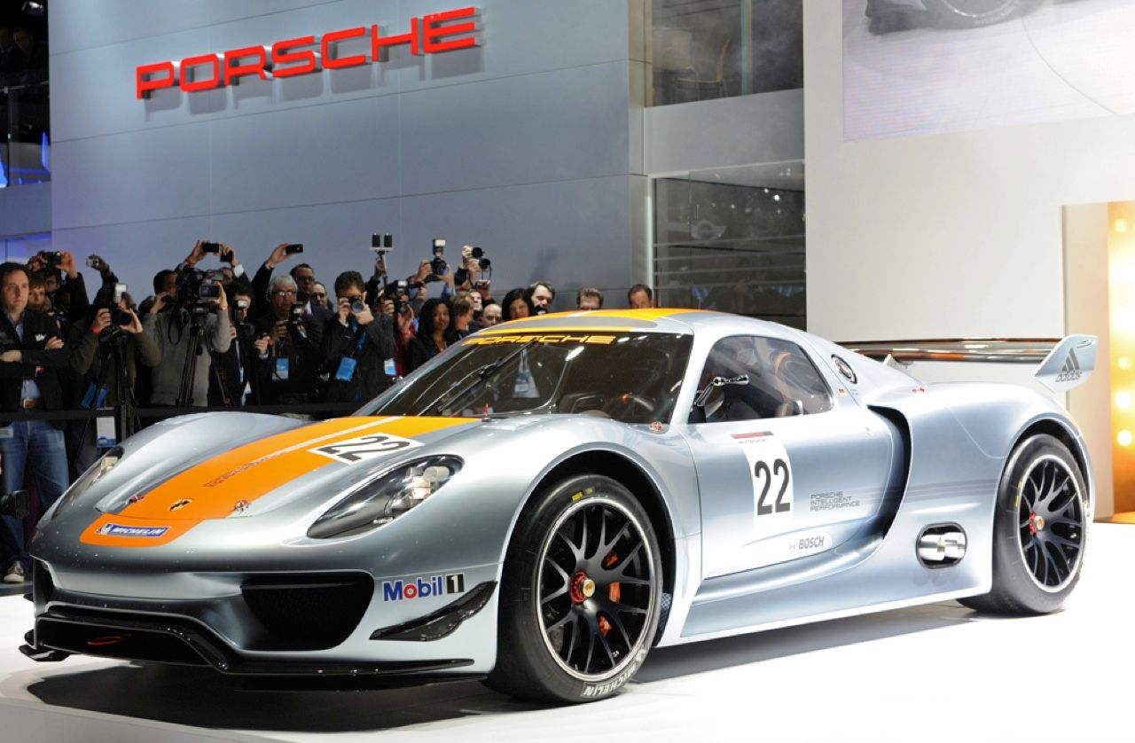 "Admit it. The words ""hybrid-electric vehicle"" don't bring the Porsche 918 RSR concept car to mind. This car, a version of the 911 GT3 R hybrid race car that stores the energy from regenerative braking in a flywheel, really flies. The charge accumulator feeds twin 75-kilowatt electric motors on the Porsche's front wheels, boosting the car's maximum power output to 572 kW."